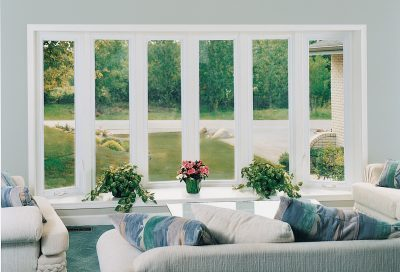 Inside view of bow windows overlooking landscaping